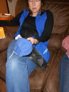 Blue hat, blue jeans, blue vest.