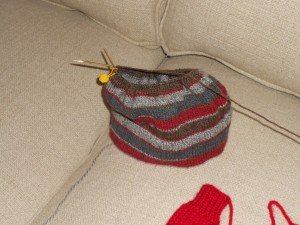 Little hat with one mitten in the corner.